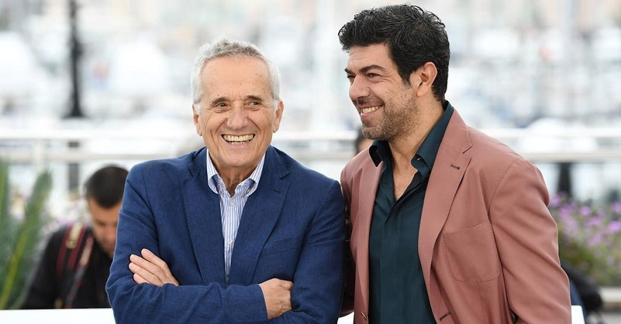 Marco Bellocchio e Pierfrancesco Favino sorridenti al Festival di Cannes 2019